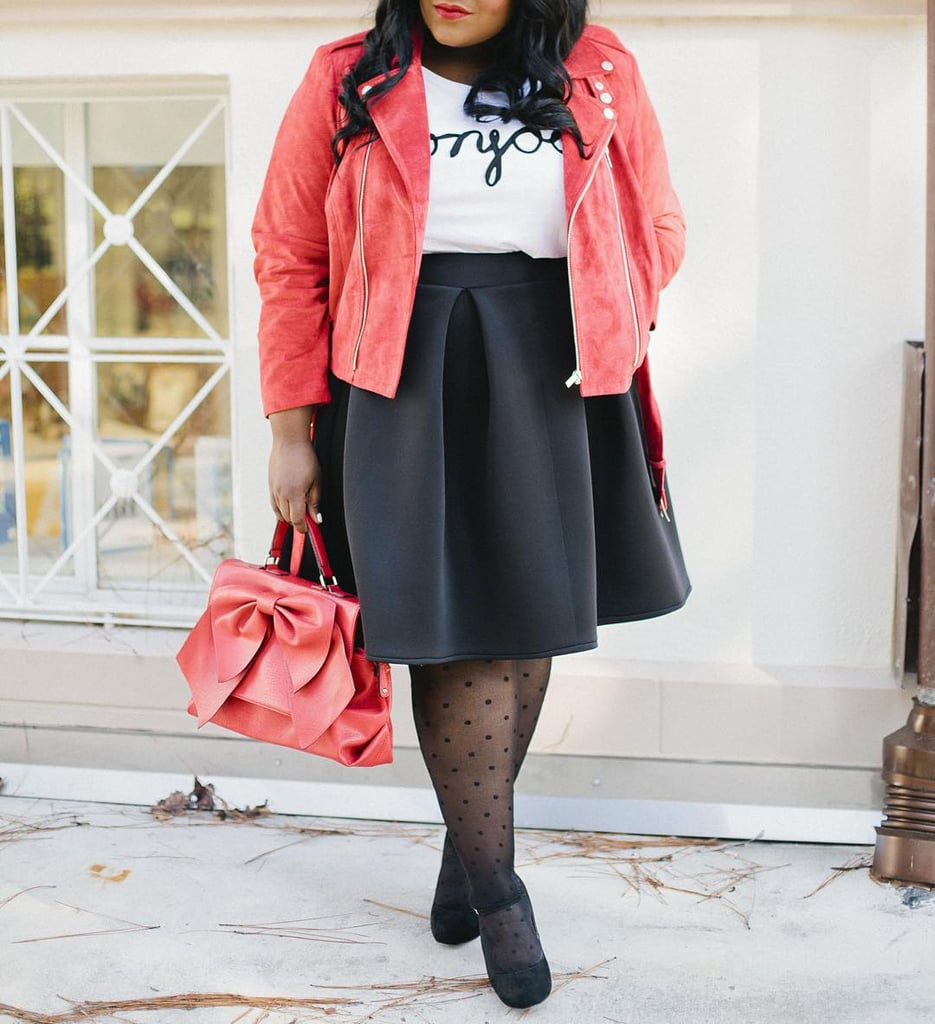 A White Graphic Tee, a Full Skirt, Spotted Tights, Heels, and a Red Jacket