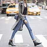 Style Your Boots With a Trench Coat, a Black Crop Top, and Skinny Jeans
