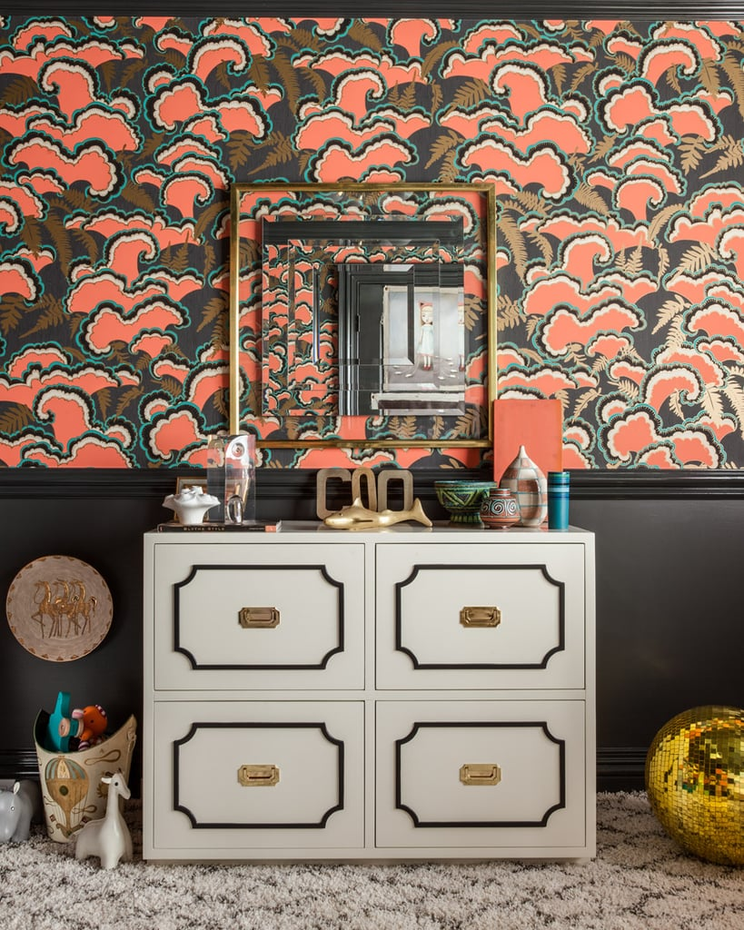 """I pushed the envelope and created a sense of theatrics and drama with the space by using layers of pattern and pops of color to energize and inspire,"" says Tamara. She chose a five-color (including metallic gold) hand-screen-printed wallpaper from Portland-based Makelike called lush. The wallpaper, designed by Mary Kysar, uses water-based inks on recyclable paper. For the rest of the walls, Pratt & Lambert's Anthracite did the trick, using oil-based high gloss on the trim work and ceiling, and satin on the walls. The Nurseryworks Uptown Changer ($1,200), also designed by Tamara, easily transforms into bedroom or office storage, or even a dining room credenza once tots are out of diapers. Photos courtesy of: Marco Ricca"
