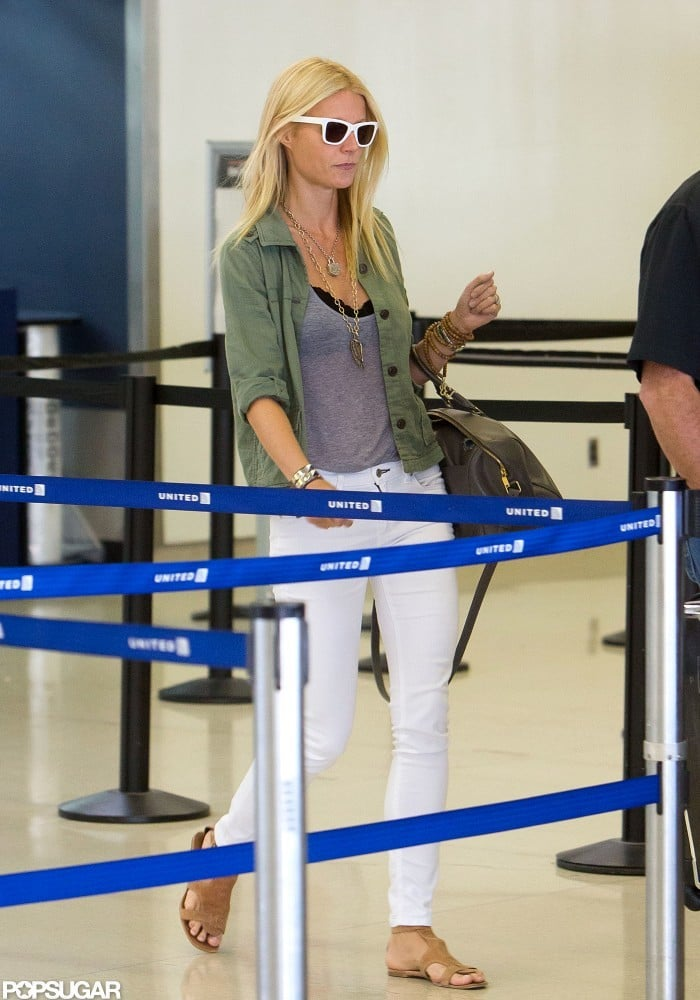 Gwyneth Paltrow was well-accessorized at LAX yesterday. She paired a loose gray tee with a black bra, then piled on the necklaces and added white sunglasses. Gwyneth's California style was on display after she spent time in North Carolina earlier this Summer working on Iron Man 3. She's also just landed a new big-screen role in the foodie film Blood, Bones & Butter and will produce the Stand Up to Cancer telethon on Sept. 7.  With her GOOP newsletter on hiatus this month, Gwyneth lent her web expertise to her pal Jay-Z. On his site, Life + Times, Gwyneth shared her Summer playlist. The track listing includes songs from Frank Ocean, Grimes, Hot Chip, and a long list of hip-hop stars.