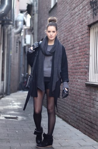 Add interest to all-black with a pair of sporty kicks. Source: Lookbook.nu