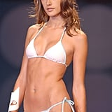 Alessandra Ambrosio wore a white bikini at Sao Paulo Fashion Week in June 2003.