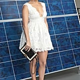 Jennifer Lopez posed in a white lace Chanel dress before the designer's Paris Fashion Week show.