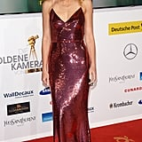 Radiating in a sequined Prada gown at the Golden Camera Awards in 2014.