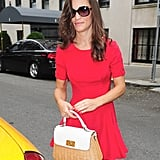 Pippa is a lady in red in Misha Nonoo.