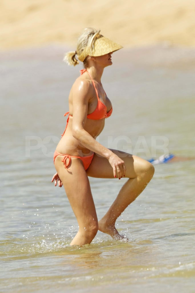Cameron Diaz hit the beach in Hawaii with her family on Sunday. She wore a bright orange bikini to dip in the water and lounge in the sand. Cameron traveled to the islands on Saturday, but has since returned to LA. She landed at LAX last night sporting a fresh tan. Cameron's been on the go lately, having visited NYC and Switzerland recently. Her busy schedule will continue when she kicks off promotions for What to Expect When You're Expecting before its May release.