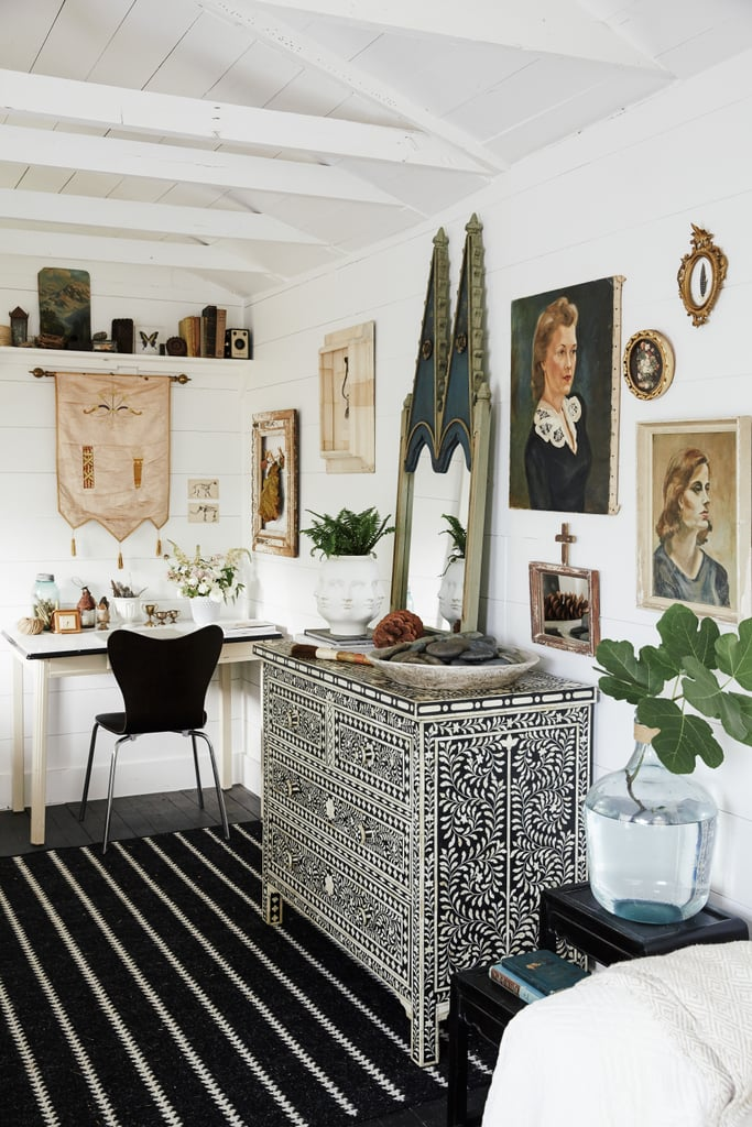 A pearl-inlay dresser, vintage paintings, and plants make the room feel rich and full of character. Source: Cody Ulrich via Homepolish