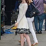 Lily Collins walked into the Good Morning America studio in a demure lace-trimmed LWD.