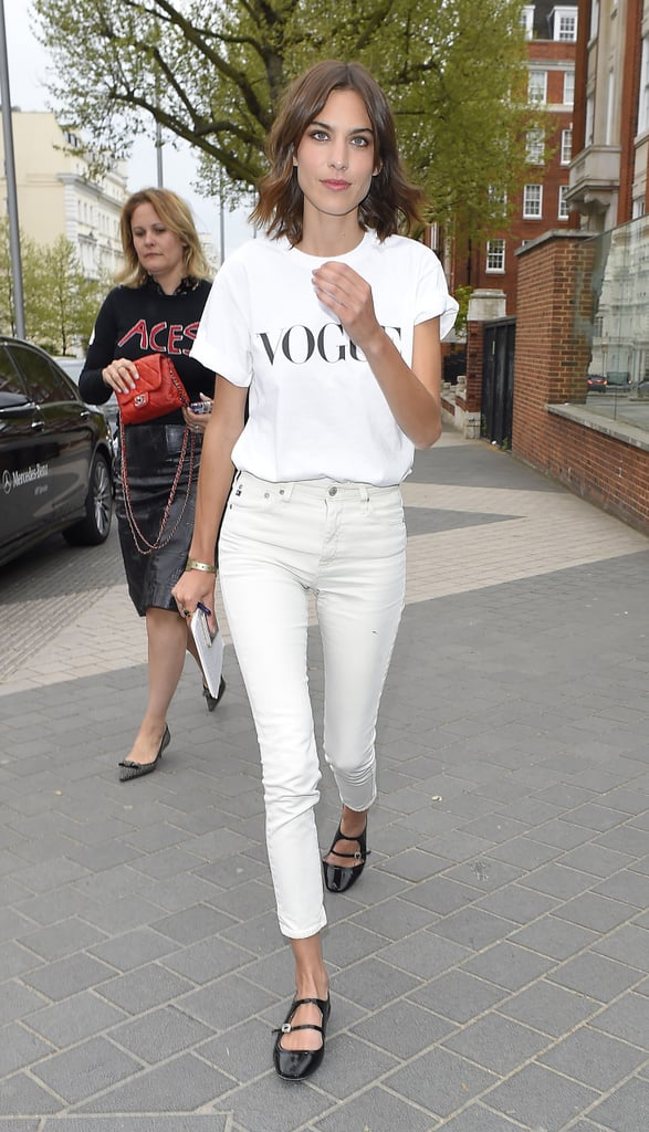 Alexa Chung wore white on white and finished the look with a pair of black strappy flats.