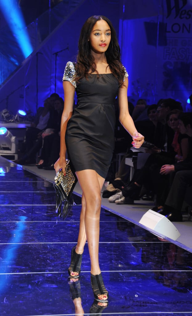 >> After giving birth in December, Jourdan Dunn only made one appearance on the Fall 2010 catwalks — at Aquascutum — which could be chalked up to the fact that during Milan Fashion Week, her boyfriend (and father of her son) was arrested for possession of cocaine with intent to supply. Last night, in her first public appearance since, Jourdan walked at Westfield shopping center in London — her second runway show post-birth — to help raise money for Fashion for Relief, much to the delight of spectators.