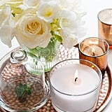 Add a candle to your vanity tray and complete the look with fresh flowers.