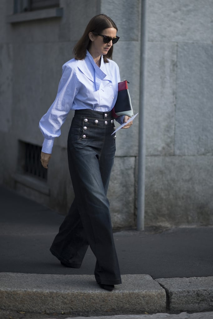Wide-leg denim trousers with buttons feel way more business professional than anything else, especially when worn with pointy toed shoes and a modest top.