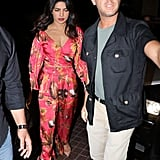 At the JW Marriott, Priyanka wore a red crop top and high-waisted pants covered with a tropical print.