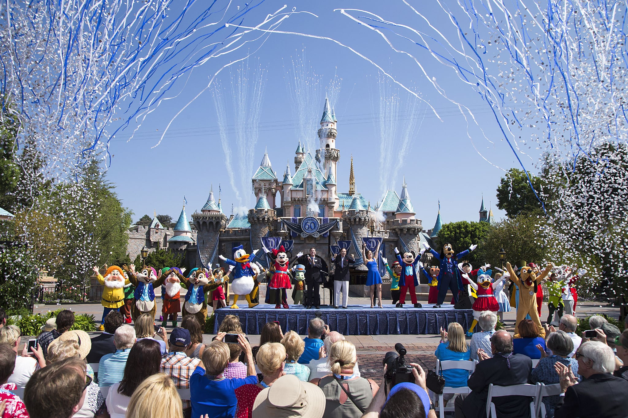 ANAHEIM, CA - JULY 17:  In this handout photo provided by Disney parks, Mickey Mouse and his friends celebrate the 60th anniversary of Disneyland park during a ceremony at Sleeping Beauty Castle featuring Academy Award-winning composer, Richard Sherman and Broadway actress and singer Ashley Brown July 17, 2015 in Anaheim, California.  Celebrating six decades of magic, the Disneyland Resort Diamond Celebration features three new nighttime spectaculars that immerse guests in the worlds of Disney stories like never before with