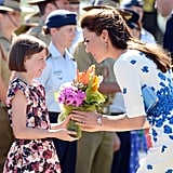 In April 2014, Kate received flowers from a 9-year-old girl while visiting the Royal Australian Airforce Base.
