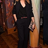Working a riff on the suit, Olivia polished off her separates with sporty shoes at a London Fashion Week party.