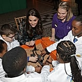 Kate looked thrilled to be hanging out with a group of kids at a tea party at the Natural History Museum in London in November 2016.