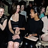 Bradley Cooper's ex-girlfriends Renée Zellweger and Zoe Saldana caught up with Rebecca Hall and January Jones at the Miu Miu fashion show in Paris.