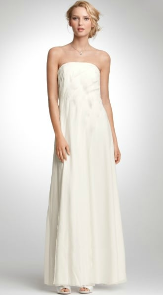With a clean strapless neckline and undersated silhouette, this has all the makings of a traditional dress for a truly classic bride.  Ann Taylor Juliet Strapless Silk Gown ($425)