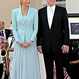 Charlene kept the accessories simple with no veil or hat for the ceremony, which took place in the Throne Room of the Prince's Palace in Monaco. The next day, the new princess was all in white as she wore full-length Armani for her religious wedding.