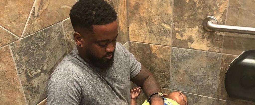 Dad Changes Son's Diaper on His Lap in Public Bathroom