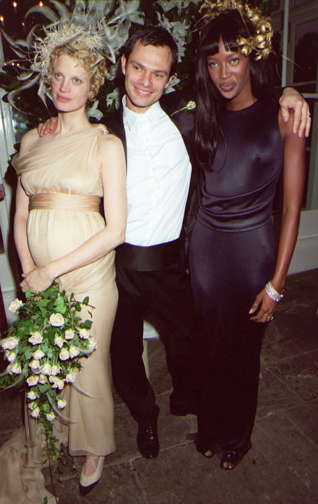 Kristen McMenamy posed with husband Miles Aldridge and Naomi Campbell in October 1997. McMenamy wore custom Karl Lagerfeld.