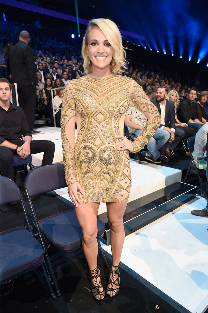 """Carrie Underwood made her way to the CMT Music Awards in Nashville on Wednesday looking as stunning as ever. Clad in a gorgeous flowing dress, the country singer beamed as she posed for pictures with husband Mike Fisher on the red carpet. Inside, Carrie brought the house down with an epic performance of her song """"Church Bells"""" and took home awards for female video of the year and CMT performance of the year for her single """"Smoke Break."""" She also linked up with a few pals, including Tim McGraw, Keith Urban, and Nicole Kidman. Most recently, Carrie made a triumphant return to American Idol, where she took the stage multiple times throughout the night. Keep reading for more photos, then get a sweet peek at Carrie's adorable son, Isaiah."""