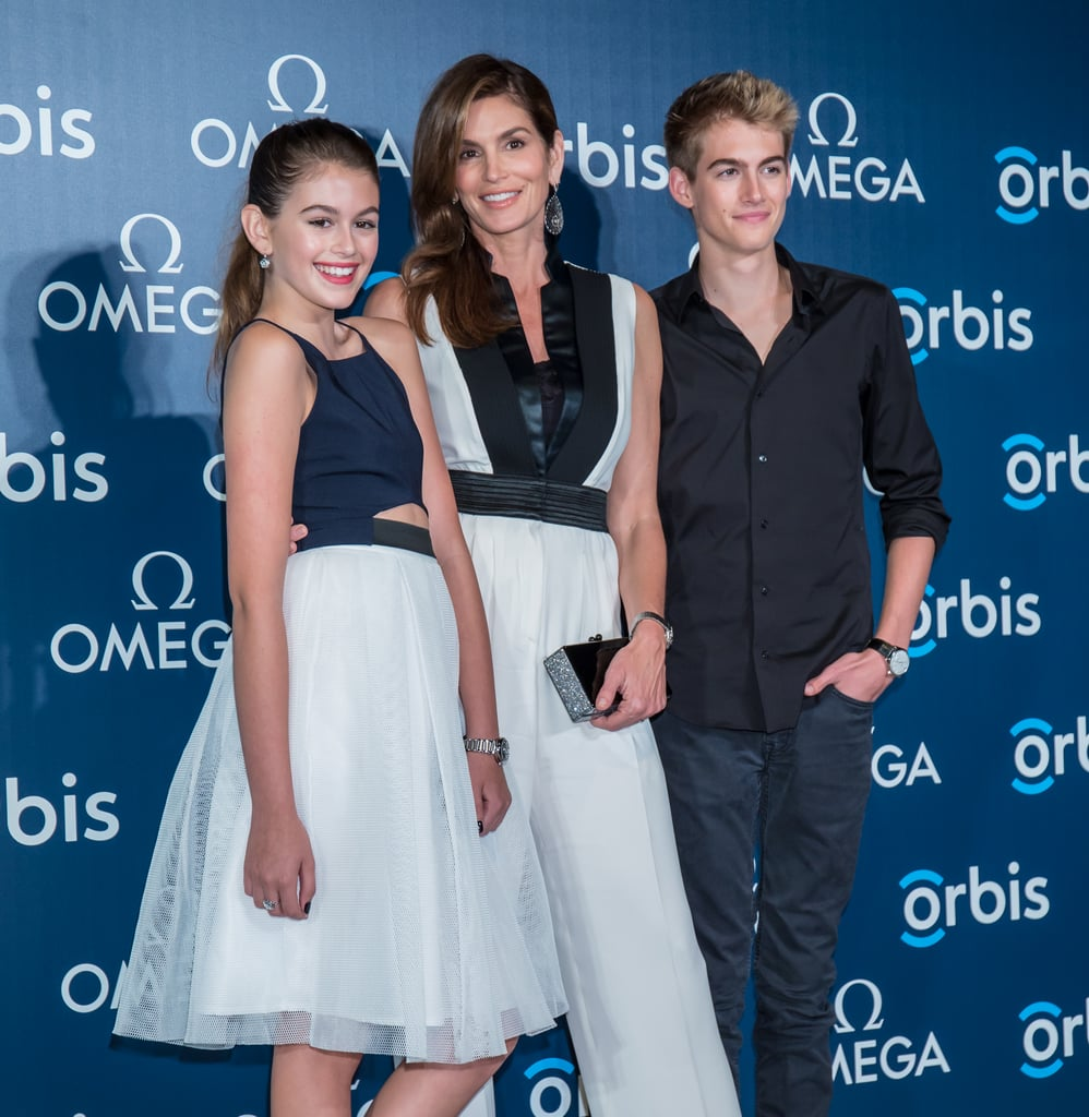 Cindy Crawford had her kids, Kaia and Presley, by her side at a special event for OMEGA in Hong Kong on Tuesday. She's been sharing the spotlight with her family frequently this year, having also hit the red carpet for a similar OMEGA event together in February and during the Tomorrowland premiere in May. It's obvious Kaia and Presley got their mom's (and dad Rande Gerber's!) good genes, but it was even more apparent that Kaia is the spitting image of Cindy when the model mom posted a picture of her 13-year-old daughter on Instagram at the beginning of June.