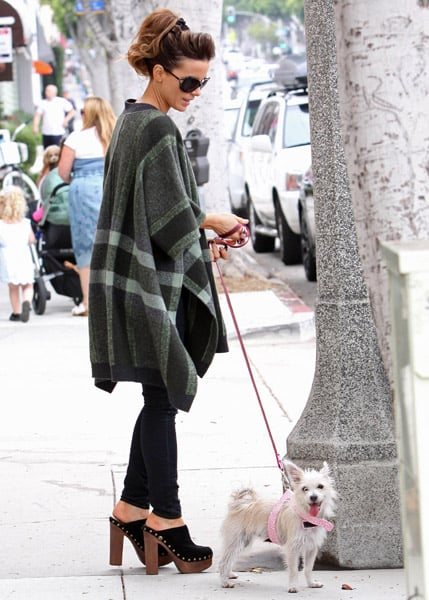 Kate Beckinsale walks her pup in some steep clogs, not to mention a super cool plaid poncho.