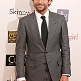 Bradley Cooper wore a gray suit on the red carpet.