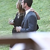Jennifer Aniston put her arm around Justin Theroux.