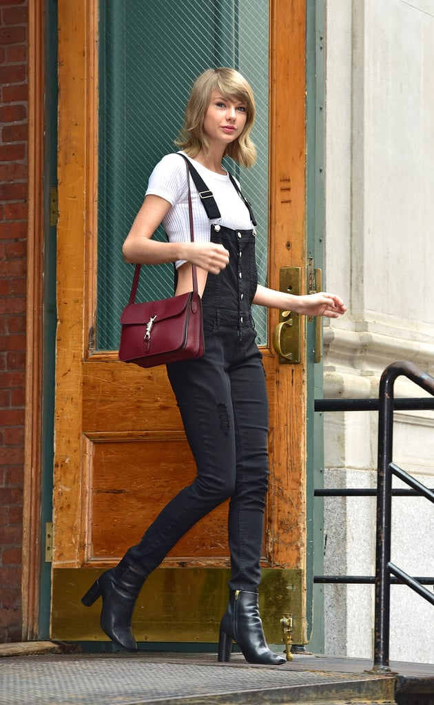 Taylor Swift was spotted leaving her apartment in a sexy overalls look.
