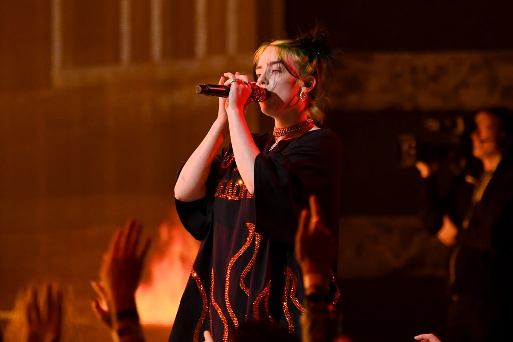 "If there was ever any doubt that Billie Eilish would turn the American Music Awards stage upon its head, her Sunday night performance completely dashed them. Along with her 22-year-old brother Finneas, the Grammy-nominated 17-year-old performed on the AMAs stage for the first time, playing her well-known hit ""All the Good Girls Go to Hell."" The stage was lit with fire as Eilish wandered the stage in a black-and-red bedazzled outfit reading, ""No Music on a Dead Planet."" Not only did Eilish completely bring the house down, but she was also nominated for six awards, including favorite new artist and favorite pop/rock album for When We All Fall Asleep, Where Do We Go?. Watch her rocking performance ahead!      Related:                                                                                                           Billie Eilish's First-Ever AMAs Appearance Was Off the Chain"