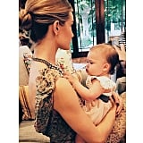 Rosie Huntington-Whiteley cradled an adorable baby.