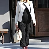 For an easy but stylish approach to everyday dressing, Gwen stuck to a black tank and Hatch drawstring pants, then added interest with the chicest of white moto jackets and a pair of red booties.