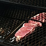 Add Steaks to Cool Side of Grill