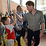 Prince Harry was all about the kids during a stop at the Wigan Youth Zone, a facility that provides a safe and fun environment for young people with disabilities, in July.