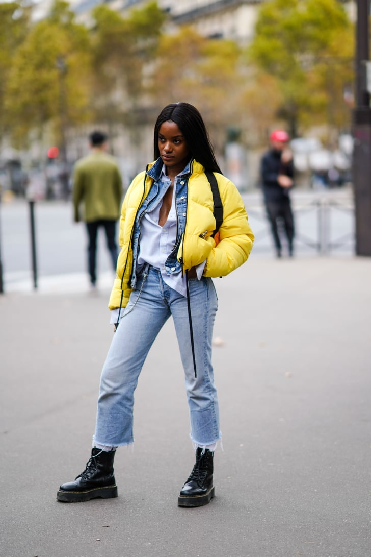 layer up in a yellow puffer and combat boots  winter