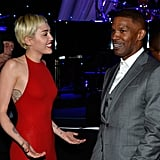 Miley Cyrus and Jamie Foxx had a spirited chat at Clive Davis's gala.