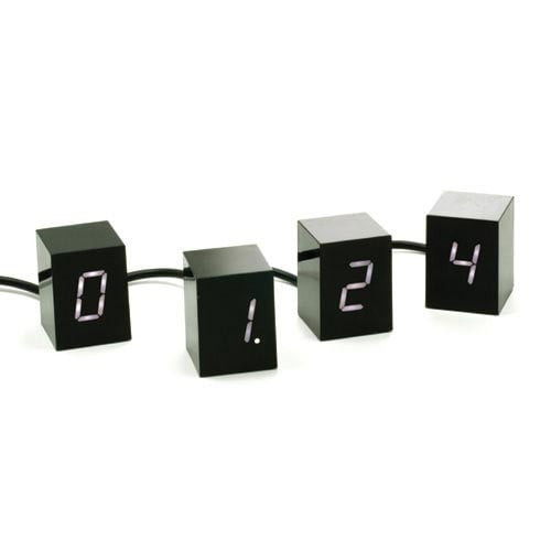 Add some visual interest to your tabletop with the Areaware Numbers LED Clock ($100), which includes four two-inch tall cubes that each feature one digit.