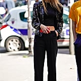 A flashy sequined blazer gets muted by all-black, well-crafted separates.