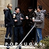 Charlize Warms Up With Coffee on Her Chilly Boston Set