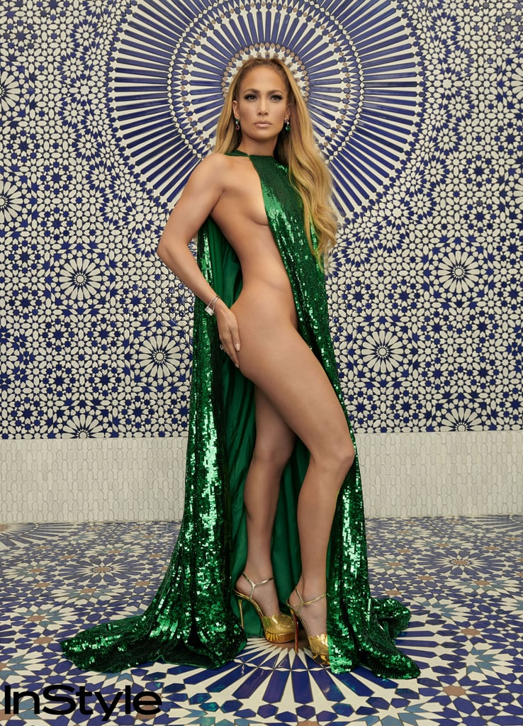 "Jennifer Lopez wore another green dress that is practically screaming, ""Oh, that Versace dress? I don't know her."" The 49-year-old multi-hyphenate is stunning the internet in several Valentino looks as the cover star for InStyle's December 2018 issue. The most jaw-dropping photos, however, are of Jennifer wearing a sequin Valentino Haute Couture cape with absolutely nothing else on — well, except for diamonds.  In the interview, Jennifer spoke about her body image and how it's helped influence a collective, and long overdue, embrace of curvier figures. ""In my family, curves were glorified and part of the culture,"" Jennifer told the magazine. ""It was just like, 'Jennifer has a big butt, and it's good.'""  Despite her sophisticated style, Jennifer continues to insist that she is indeed still Jenny from the block. ""It's what I still often wear to this day, the big hoops and, you know, gold jewellery,"" she said about her style. ""I always like to mix the glam with a bit of the hood."" Read the full interview when the issue goes on sale Nov. 9, and enjoy pictures of Jennifer in the already iconic green dress ahead."