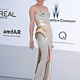 Milla Jovovich wore Versace to the amfAR Cinema Against AIDS gala.