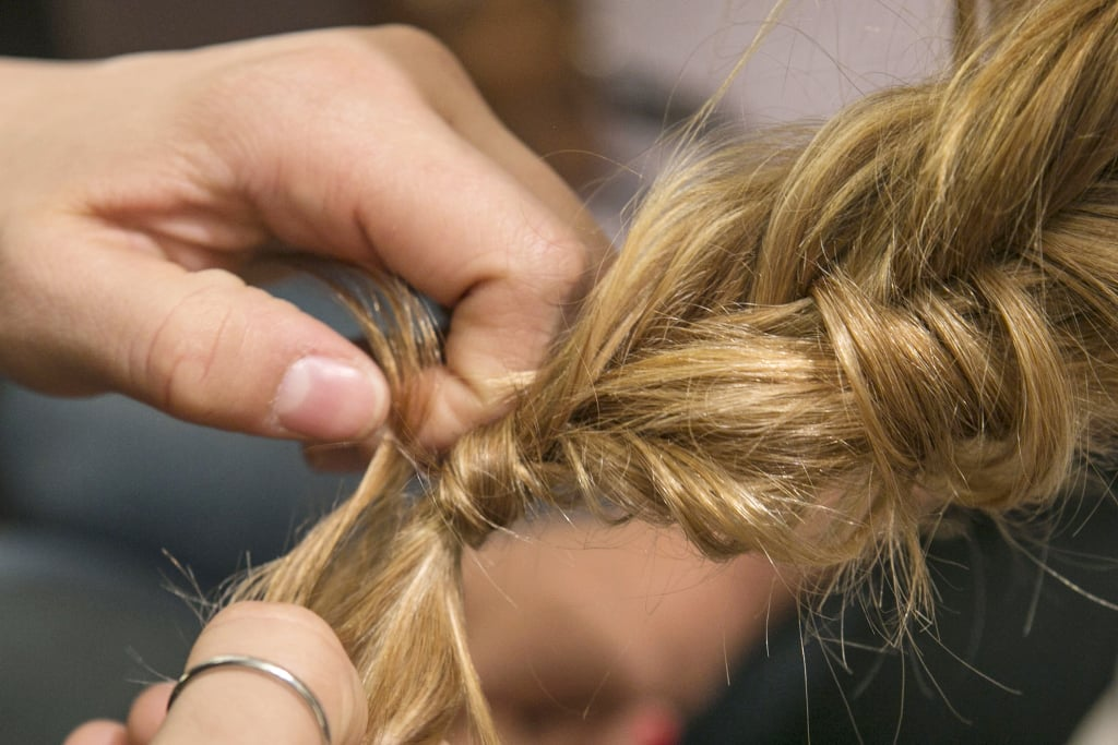 If you want to get a little fancy, before you completely secure the elastic, wrap a section of hair around the elastic before pulling the hair through the final loop of the band.