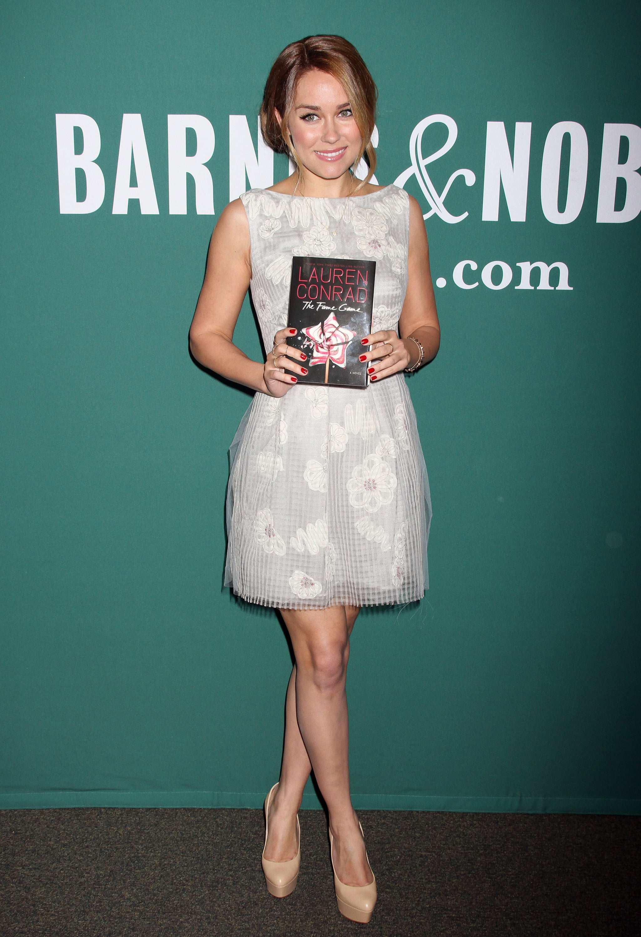 Lauren Conrad got back to basics with a textured floral dress by Lela Rose and nude platform pumps at a book signing in NYC. Lesson from Lauren: accentuate your gorgeous gams with leg-lengthening pumps.