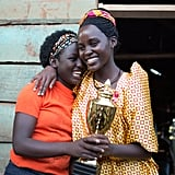 POPSUGAR Australia: Congratulations on the new movie! Can you tell us a bit about it and what drew you to the role of Harriet?  Lupita Nyong'o: Queen of Katwe is about a young Ugandan girl who grows up in abject poverty in Uganda's largest slum, and she stumbles upon chess. With the help of her mentor, she ends up becoming a very young chess prodigy. I play her mother, the mother of four children — a young mother who had her first child when she was 15, and who is not such a big fan of lofty dreams because of the hard life she's led. She has to come to a place where she has a role to play in supporting her daughters dreams and permitting her to pursue them.  PS: What was it about the role that made you want to sign up?  LN: I liked that Harriet saw the world in such a different way to how I see the world. I grew up obviously in a house with a little more privilege and with a mother and father who really embraced and encouraged the idea of dreaming out loud and reaching for more than you think possible. And Harriet, because she's had such a hard life, she is suspicious of dreams and is quite distrustful of wanting any more than what you already have or know. I liked the idea that trying to see the world from her perspective and going on the journey with her, where she realises [she needs to] act out of love and hope rather than fear.