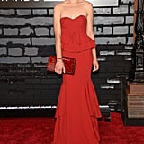 Actress Crystal Reed played it safe in a crimson-coloured strapless gown and matching clutch.
