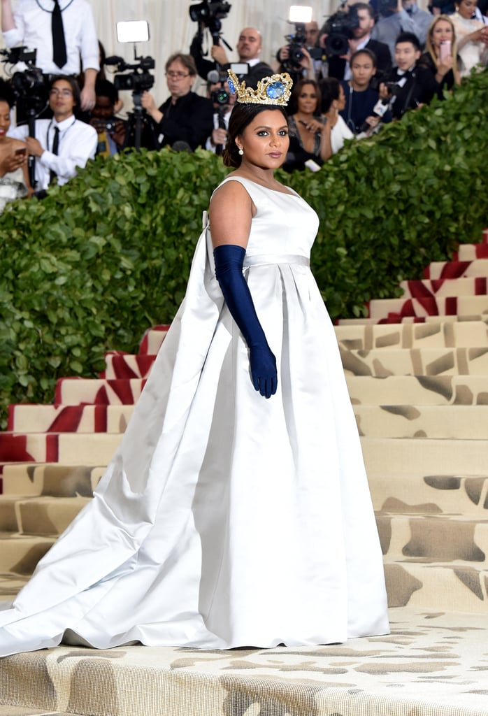 Mindy stunned at the 2018 Met Gala in a satin Vassilis Zoulias gown complete with Fred Leighton jewels, Giuseppe Zanotti shoes, and a gemstone-encrusted crown.