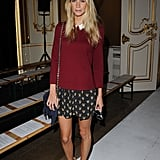 Poppy went preppy for the Fashion East show on day two of LFW — she paired a maroon top with printed silk shorts (both by Sandro) with Givenchy heels and a chain-strap bag by Meli Melo.